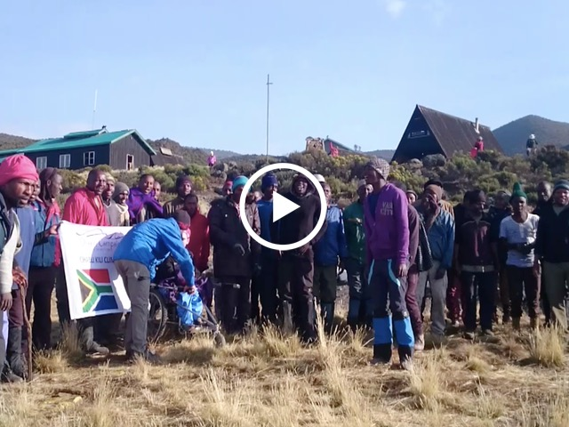 The porters sing for Chaeli and the Kilimanjaro climbers