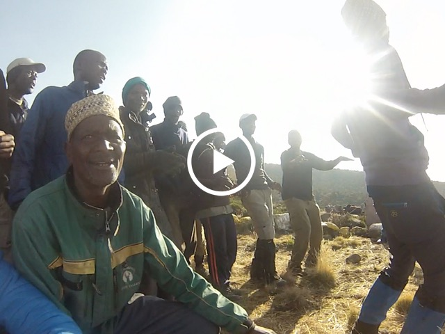 Kilimanjaro porters singing and dancing