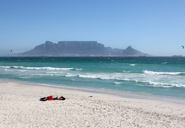 The view of Table Mountain from the Table Bay beaches frames the scene in a picture-perfect postcard.