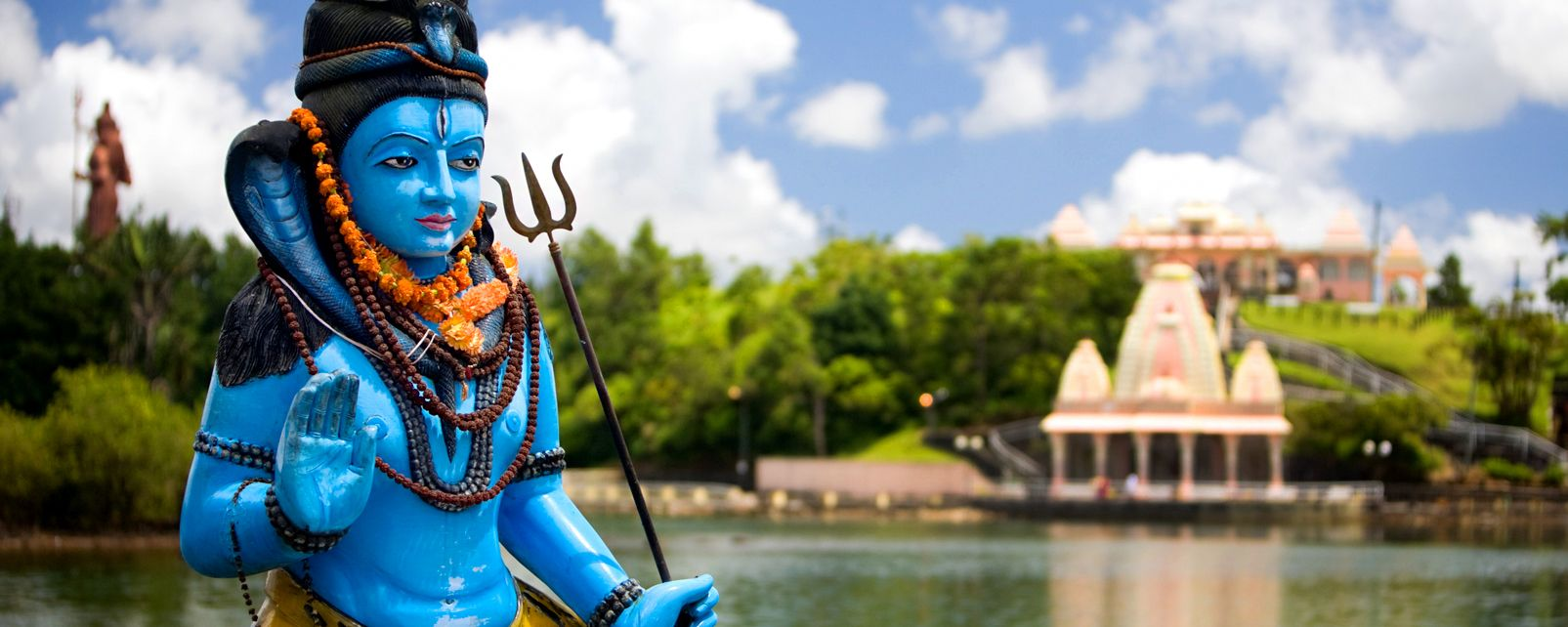 Grand Bassin is surrounded by candy-coloured statues of gods and Hindu temples  Credit: Easyvoyage