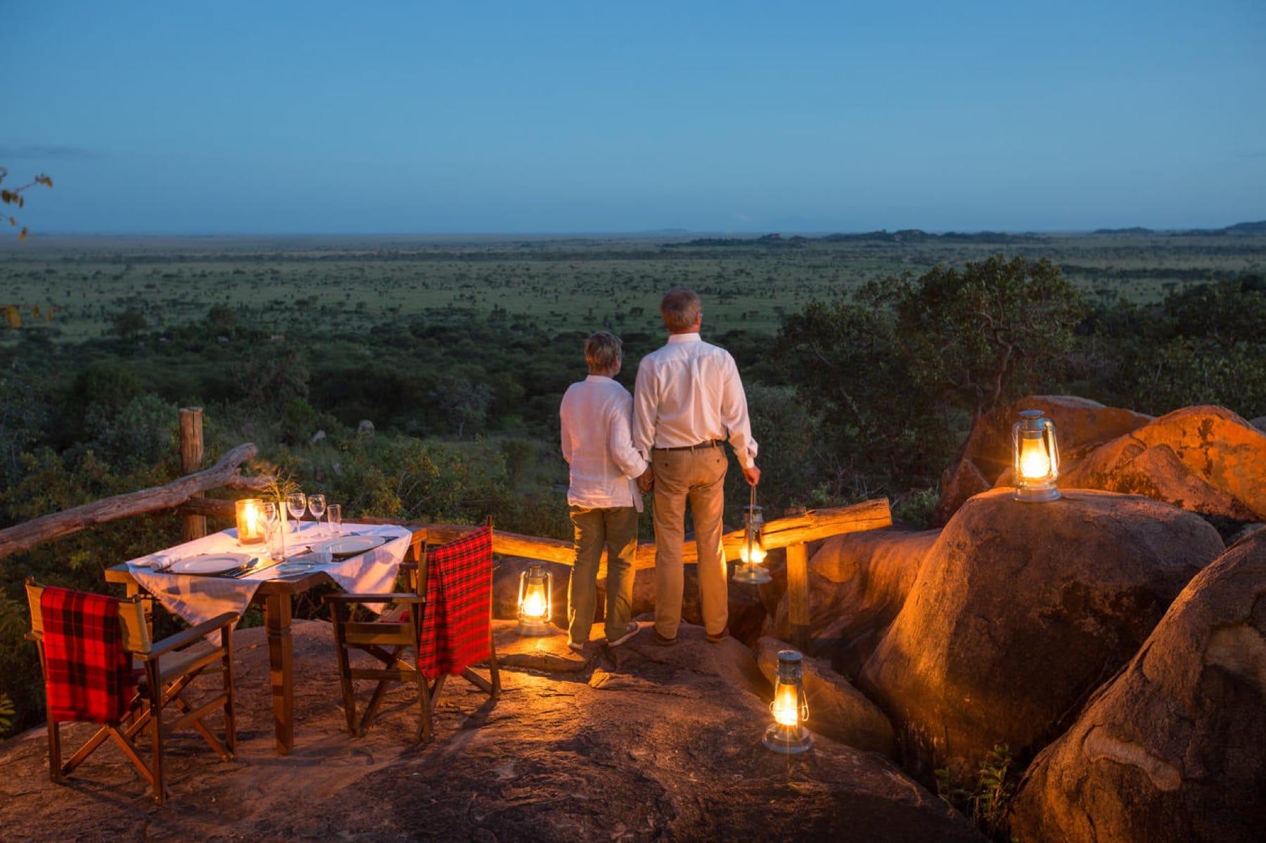 Couples overlooking the Serengeti Plains Credit: Wetu.com