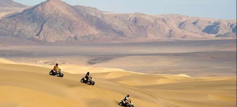 quad biking dunes
